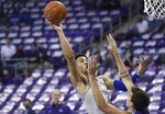 Kansas forward Jalen Wilson (10) shoots over TCU guard Francisco Farabello during the first half of an NCAA college basketball game Tuesday, Jan. 5, 2021, in Fort Worth, Texas. (AP Photo/Ron Jenkins)
