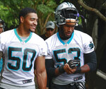 Carolina Panthers NFL football rookie defensive player Brian Burns, right, walks to practice alongside fellow defensive rookie Christian Miller Monday, June 3, 2019, in Charlotte, N.C. (AP Photo/Jason E. Miczek)