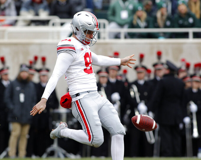 Ohio State's Drue Chrisman punts during the first quarter of an NCAA college football game against Michigan State, Saturday, Nov. 10, 2018, in East Lansing, Mich. (AP Photo/Al Goldis)