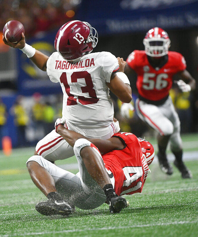 Georgia linebacker Channing Tindall (41) hits Alabama quarterback Tua Tagovailoa (13) during the second half of the Southeastern Conference championship NCAA college football game, Saturday, Dec. 1, 2018, in Atlanta. (AP Photo/John Amis)