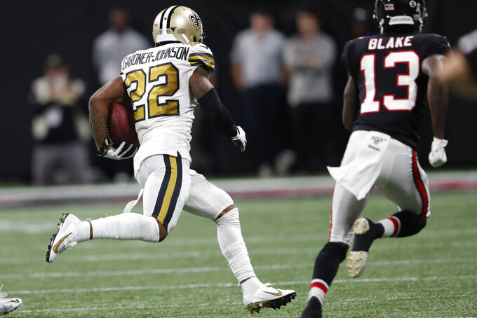 New Orleans Saints defensive back Chauncey Gardner-Johnson (22) runs the ball after an interception against the Atlanta Falcons during the second half of an NFL football game, Thursday, Nov. 28, 2019, in Atlanta. (AP Photo/John Bazemore)