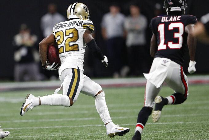 New Orleans Saints defensive back Chauncey Gardner-Johnson (22) runs the ball after an interception against the Atlanta Falcons during the second half of an NFL football game, Thursday, Nov. 28, 2019, in Atlanta. (AP Photo/John Bazemore)