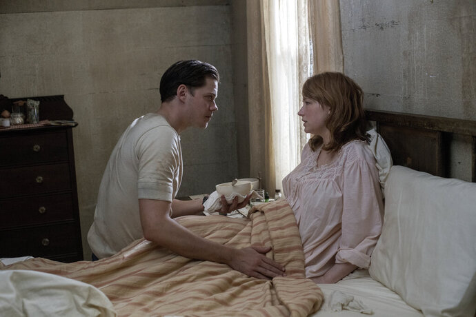 This image released by Netflix shows Bill Skarsgård, left, and Haley Bennett in a scene from