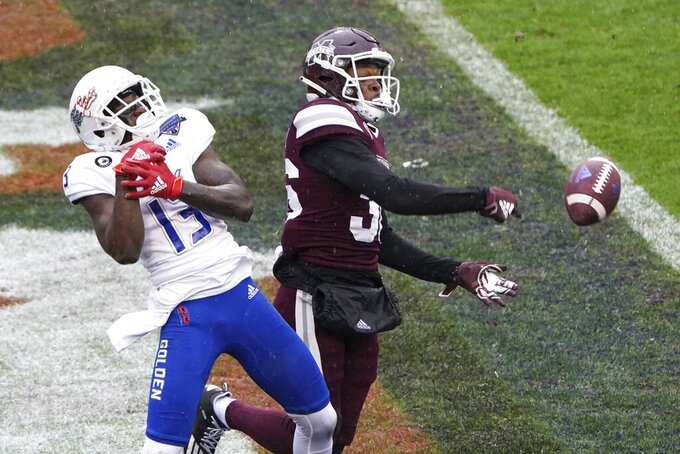 Mississippi State cornerback Jay Jimison (36) breaks up the pass intended for Tulsa wide receiver Josh Johnson (13) during the first half of the Armed Forces Bowl NCAA college football game Thursday, Dec. 31, 2020, in Fort Worth, Texas. (AP Photo/Jim Cowsert)