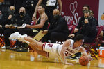 Indiana's Trey Galloway (32) dives for a loose ball during the second half of an NCAA college basketball game against Purdue, Thursday, Jan. 14, 2021, in Bloomington Ind. Purdue won 81-69. (AP Photo/Darron Cummings)