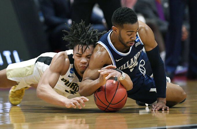 Purdue's Carsen Edwards, left, and Villanova's Phil Booth dive for a loose ball during the first half of a second round men's college basketball game in the NCAA tournament, Saturday, March 23, 2019, in Hartford, Conn. (AP Photo/Jessica Hill)