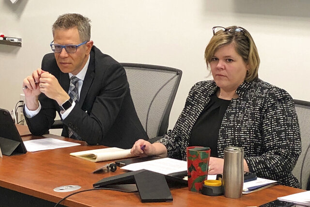 In this Wednesday, Feb. 12, 2019 photo, Dr. Michael Schottenstein, left, president of the State Medical Board of Ohio, and its executive director, Stephanie Loucka, listen to discussion about a review of old cases during a meeting in Columbus, Ohio. The board is reviewing about 2,000 old complaints alleging sexual misconduct or impropriety by doctors to determine whether they were properly closed, and the project started off much slower than initially anticipated. (AP Photo/Kantele Franko)