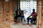 In this photo taken on Sunday, May 13, 2018, people suspected of having the Ebola Virus wait at a treatment center in Bikoro Democratic Republic of Congo. Congo's latest Ebola outbreak has spread to a city of more than 1 million people, a worrying shift as the deadly virus risks traveling more easily in densely populated areas. Two suspected cases of hemorrhagic fever were reported in the Wangata health zones that include Mbandaka, the capital of northwestern Equateur province. The city is about 150 kilometers (93 miles) from Bikoro, the rural area where the outbreak was announced last week, said Congo's Health Minister Oly Ilunga. (AP Photo/John Bompengo)