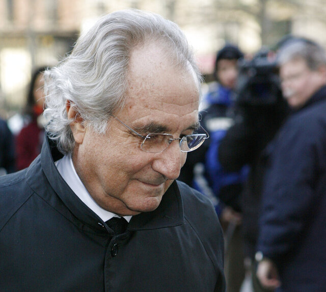 FILE - In this Jan. 14, 2009 file photo, Bernard Madoff arrives at Federal Court in New York. On Thursday, Sept. 24, 2020, a federal appeals court said that investors who profited from Madoff's massive Ponzi scheme must pay back their profits even if they knew nothing of it. Madoff is serving a 150-year prison sentence imposed after he pleaded guilty to federal charges in 2009. (AP Photo/Stuart Ramson, File)