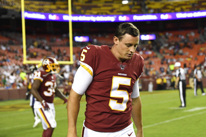 Washington Redskins punter Tress Way (5) walks off the field after his punt was blocked and recovered by the Baltimore Ravens during the second half of an NFL preseason football game at FedEx Field in Landover, Md., Thursday, Aug. 29, 2019. (AP Photo/Susan Walsh)
