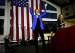 Democratic presidential candidate Sen. Elizabeth Warren, D-Mass., center, addresses an audience during a campaign event Monday, Nov. 11, 2019, in Exeter, N.H. (AP Photo/Steven Senne)