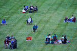 People are socially distanced as they listen to music of the Kansas City Symphony on the lawn at the Liberty Memorial Saturday, Sept. 19, 2020, in Kansas City, Mo. (AP Photo/Charlie Riedel)