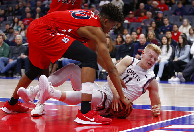 Fresno State forward Orlando Robinson, left, and Saint Mary's forward Matthias Tass, right, scramble for the ball during the first half of an NCAA college basketball game in Sacramento, Calif., Wednesday, Nov. 20, 2019. (AP Photo/Rich Pedroncelli)