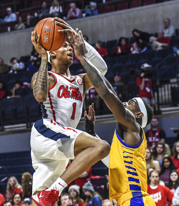 Mississippi guard Austin Crowley (1) is fouled by Cal State Bakersfield guard De'Monte Buckingham (13) during an NCAA college basketball game, Saturday, Dec, 7, 2019, in Oxford, Miss. (Bruce Newman/The Oxford Eagle via AP)