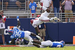 Arkansas quarterback KJ Jefferson (1) is upended by Mississippi linebacker Mark Robinson (35) as he scores a touchdown during the second half of an NCAA college football game, Saturday, Oct. 9, 2021, in Oxford, Miss. Mississippi won 52-51.(AP Photo/Rogelio V. Solis)