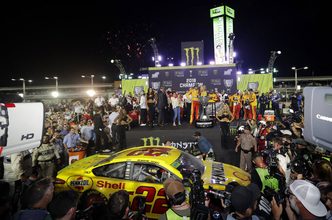 Joey Logano (22) is interviewed after winning the NASCAR Cup Series Championship auto race at the Homestead-Miami Speedway, Sunday, Nov. 18, 2018, in Homestead, Fla. (AP Photo/Lynne Sladky)