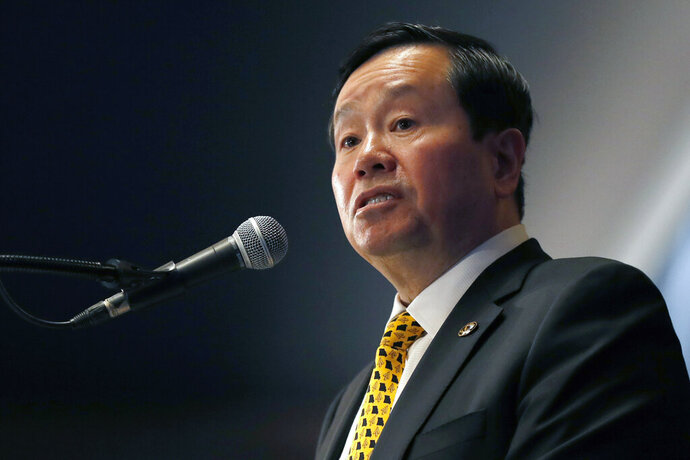 FILE - In this Dec. 10, 2019 file photo, University of Missouri system president Mun Choi speaks during a news conference in Columbia, Mo. The leader of the University of Missouri system and chancellor of its flagship Columbia campus is backtracking in the face of backlash and a possible lawsuit for blocking critical students on Twitter. Spokesman Christian Basi on Thursday, Sept. 10, 2020, said system President and Columbia Chancellor Mun Choi unblocked the students Wednesday, the same day a lawyer warned he would sue if Choi didn't do so. (AP Photo/Jeff Roberson File)