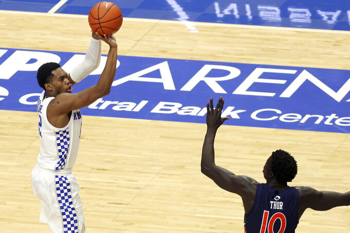 Kentucky's Keion Brooks Jr., left, shoots over Auburn's JT Thor (10) during the second half of an NCAA college basketball game in Lexington, Ky., Saturday, Feb. 13, 2021. Kentucky won 82-80. (AP Photo/James Crisp)