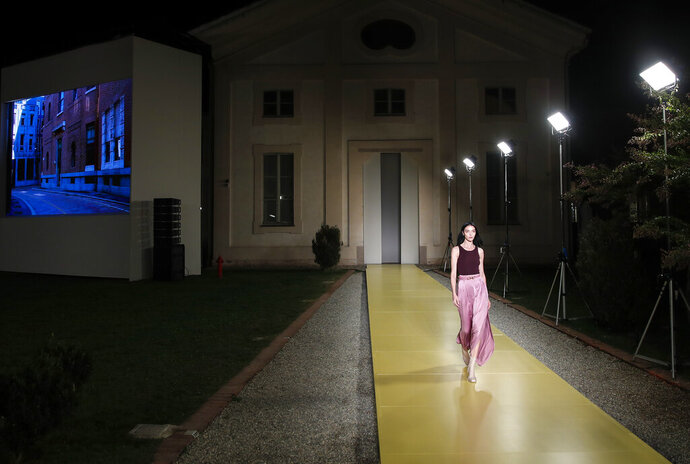 Model Mariacarla Boscono wears a creation as part of the Salvatore Ferragamo 2021 women's spring-summer ready-to-wear collection during the fashion week in Milan, Italy, Saturday, Sept. 26, 2020. (AP Photo/Antonio Calanni)