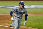 Los Angeles Dodgers' Enrique Hernandez elebrates a RBI-double against the Tampa Bay Rays during the sixth inning in Game 4 of the baseball World Series Saturday, Oct. 24, 2020, in Arlington, Texas. (AP Photo/Eric Gay)
