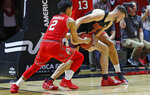 Utah guard Sedrick Barefield (2) attempt to steal the ball from Southern California forward Nick Rakocevic, right, during the second half of an NCAA college basketball game Thursday, March 7, 2019, in Salt Lake City. (AP Photo/Rick Bowmer)