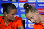 Netherlands' Sherida Spitse, left, and Netherlands goalkeeper Sari Van Veenendaal attend a press conference at the Stade de Lyon, outside Lyon, France, Saturday, July 6, 2019. Netherlands will face US in a Women's World Cup final match Sunday in Lyon. (AP Photo/Francois Mori)