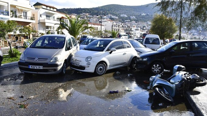Cars are piled after an earthquake at the port of Vathi on the eastern Aegean island of Samos, Greece, Friday, Oct. 30, 2020. A strong earthquake struck in the Aegean Sea between the Turkish coast and the Greek island of Samos as the magnitude 6.6 earthquake was centered in the Aegean at a depth of 16.5 kilometers, or 10.3 miles.(AP Photo/Michael Svarnias)