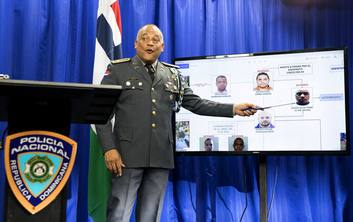 Col. Frank Felix Duran Mejia, spokesperson for the Dominican National Police, leads a press conference regarding the investigation into the shooting of former Boston Red Sox baseball player David Ortiz, in Santo Domingo, Dominican Republic, Sunday, June 30, 2019. Ortiz was shot at a bar in the Dominican Republic on June 9. (AP Photo/Tatiana Fernandez)