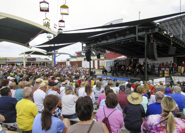 FILE - In this Aug. 10, 2017, file photo, a large crowd watches a performance at the Wisconsin State Fair near Milwaukee. The Wisconsin State Fair was canceled Thursday, May 28, 2020, due to the coronavirus pandemic, marking the first time since 1945 that the 169-year-old annual tradition will not take place. (Barry Adams/Wisconsin State Journal via AP)