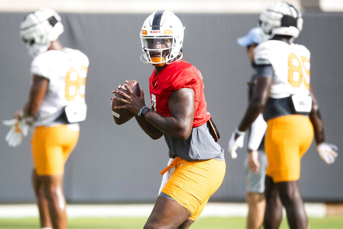 Tennessee quarterback Joe Milton throws during an NCAA college football practice Aug. 20, 2021, in Knoxville, Tenn. Tennessee coach Josh Heupel has named Milton, a transfer from Michigan, as his starting quarterback for the Volunteers' season opener Thursday night. (Brianna Paciorka/News Sentinel via AP)