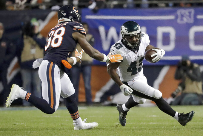 Philadelphia Eagles running back Darren Sproles (43) runs against Chicago Bears strong safety Adrian Amos (38) during the second half of an NFL wild-card playoff football game Sunday, Jan. 6, 2019, in Chicago. (AP Photo/Nam Y. Huh)