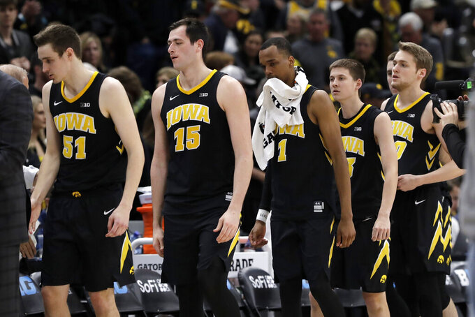 Iowa players walk off the court after an NCAA college basketball game against Michigan in the quarterfinals of the Big Ten Conference tournament, Friday, March 15, 2019, in Chicago. Michigan won 74-53. (AP Photo/Nam Y. Huh)