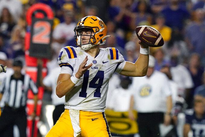 LSU quarterback Max Johnson (14) passes in the second half of an NCAA college football game against Auburn in Baton Rouge, La., Saturday, Oct. 2, 2021. Auburn won 24-19. (AP Photo/Gerald Herbert)