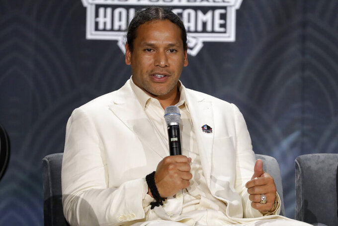 FILE - In this Feb. 1, 2020 file photo, Hall of Fame class of 2020 Troy Polamalu speaks at the NFL Honors football award show in Miami.  The roster of men entering the Pro Football Hall of Fame this weekend of Saturday, Aug. 7, 2021, features everything from the prolific passer, to the dominant defender,  and not to mention coaches.  (AP Photo/Mark Humphrey, File)