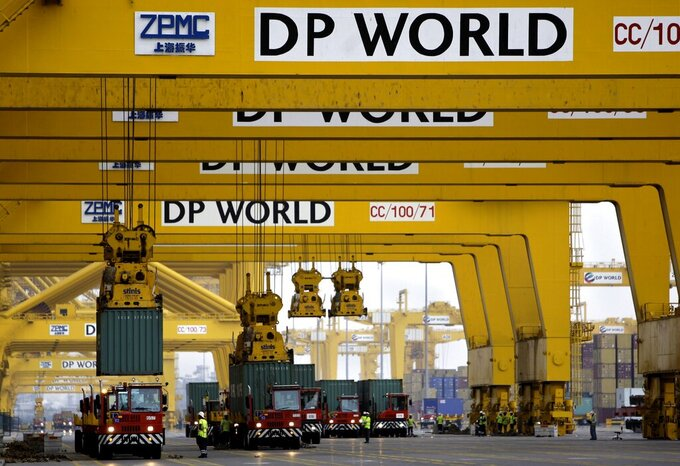FILE - In this Feb. 8, 2009 file photo, cranes off load containers at the Jebel Ali Port, in Dubai, United Arab Emirates. International port operator DP World reached a deal Thursday, Sept. 3, 2020, with one of Canada's biggest pension-fund managers to pour an additional $4.5 billion into their joint venture of ports and terminals. (AP Photo/Kamran Jebreili, File)