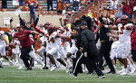 Iowa State players and coaches storm the field after their win over Texas in an NCAA college football game, Friday, Nov. 27, 2020, in Austin, Texas. (AP Photo/Eric Gay)
