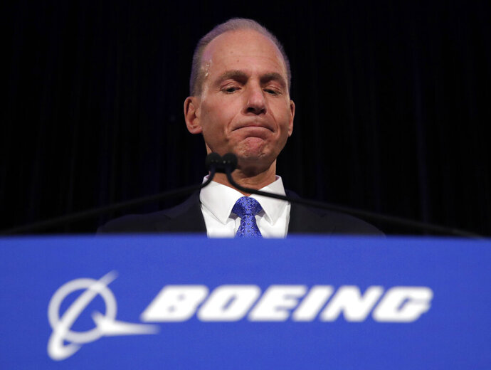 """FILE - In this Monday, April 29, 2019 file photo, Boeing Chief Executive Dennis Muilenburg speaks during a news conference after the company's annual shareholders meeting at the Field Museum in Chicago. Boeing's CEO says the company made a """"mistake"""" in handling a problematic cockpit warning system in 737 Max jets ahead of two deadly crashes of the top-selling plane. Chief Executive Dennis Muilenburg told reporters in Paris on Sunday, June 16 that the company's communication """"was not consistent,"""" calling that """"unacceptable.""""(AP Photo/Jim Young, file)"""