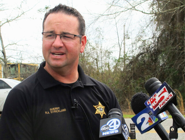 FILE - In this March 10, 2016 file photo, Colleton County Sheriff R.A. Strickland talks with members of the media about the search for multiple missing children near the community of Smoaks, S.C. The suspended South Carolina sheriff already indicted on domestic violence charges now faces additional criminal charges including giving alcohol to someone under 21 and using his power to continue a sexual relationship with an employee, authorities said. The new indictments against Strickland were unsealed Tuesday, Feb. 18, 2020. (AP Photo/Bruce Smith, File)