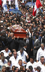 In this April 19, 2019 photo, people carry the coffin of Peru's late President Alan Garcia during his funeral procession in Lima, Peru. Garcia shot himself in the head and died Wednesday as officers waited to arrest him in a massive graft probe that has put the country's most prominent politicians behind bars and provoked a reckoning over corruption. (AP Photo/Martin Mejia)