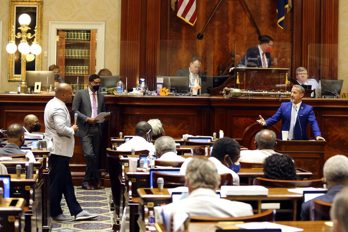 South Carolina House Minority Leader Rep. Todd Rutherford, D-Columbia, left, and Rep. Chris Wooten, R-Lexington, right, discuss a bill that would set minimum requirements for police departments in the state on Wednesday, April 28, 2021, in Columbia, S.C. The House did not take a vote on the bill. (AP Photo/Jeffrey Collins)