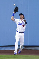 Los Angeles Dodgers center fielder Cody Bellinger (35) catches a fly ball hit by St. Louis Cardinals' Tommy Edman during the third inning of a baseball game Monday, May 31, 2021, in Los Angeles. (AP Photo/Ashley Landis)