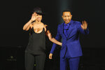 FILE - In this Jan. 27, 2014 file photo, Alicia Keys, left, and John Legend wave after their performance at The Night That Changed America: A Grammy Salute to the Beatles in Los Angeles.  Legend latest release