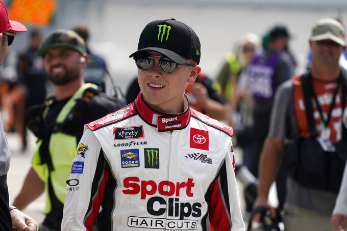 Ty Gibbs walks in the pit area before driver introductions at the NASCAR Xfinity Cup Series auto race at Michigan International Speedway, Saturday, Aug. 21, 2021, in Brooklyn, Mich. (AP Photo/Carlos Osorio)