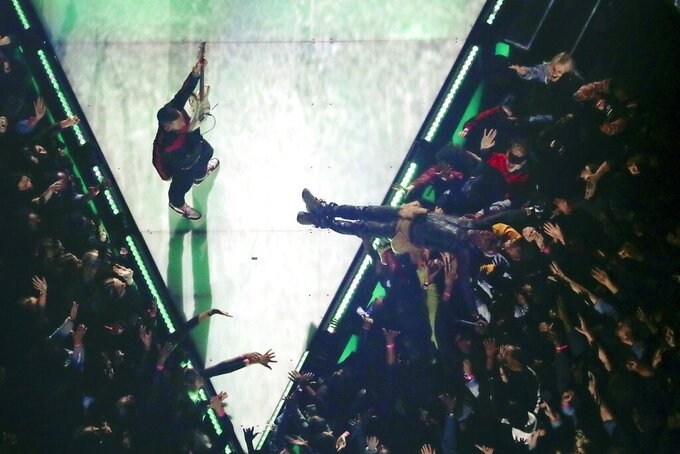 Adam Levine of Maroon 5, left, performs as Travis Scott is carried by the crowd during halftime of the NFL Super Bowl 53 football game between the Los Angeles Rams and the New England Patriots Sunday, Feb. 3, 2019, in Atlanta. (AP Photo/Morry Gash)