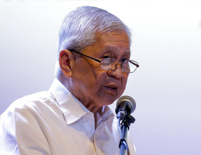 FILE - In this Friday, July 12, 2019, file photo, former Philippine Foreign Secretary Albert del Rosario delivers his speech during a forum on the South China Sea in metropolitan Manila, Philippines. He said that President Rodrigo Duterte's failure to seek Chinese compliance with an arbitration ruling has resulted in