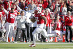 Nebraska running back Devine Ozigbo (22) runs for his second touchdown during the first half of an NCAA college football game against Minnesota in Lincoln, Neb., Saturday, Oct. 20, 2018. (AP Photo/Nati Harnik)
