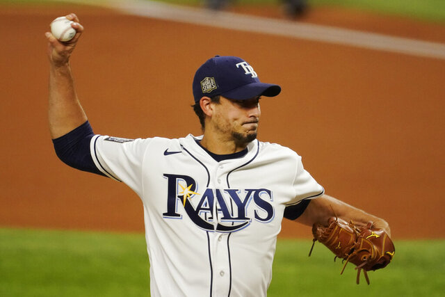 Tampa Bay Rays starting pitcher Charlie Morton throws against the Los Angeles Dodgers during the first inning in Game 3 of the baseball World Series Friday, Oct. 23, 2020, in Arlington, Texas. (AP Photo/Tony Gutierrez)