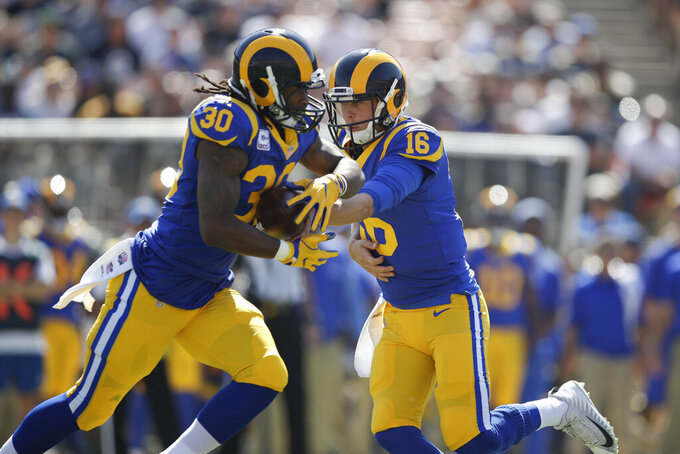 FILE - In this Sunday, Oct. 8, 2017, file photo, Los Angeles Rams quarterback Jared Goff (16) hands the ball to Todd Gurley (30) during an NFL football game against the Seattle Seahawks, in Los Angeles. The Rams enter the 2019 season as favorites again with Goff and Gurley leading a dynamic offense and Aaron Donald anchoring the defense. (AP Photo/Jae C. Hong, File)