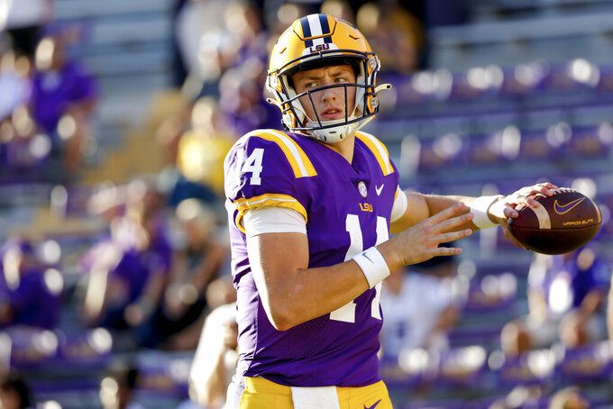 LSU quarterback Max Johnson (14) warms up prior to the kickoff at an NCAA college football game against Central Michigan in Baton Rouge, La,. Saturday, Sept. 18, 2021. (AP Photo/Derick Hingle)