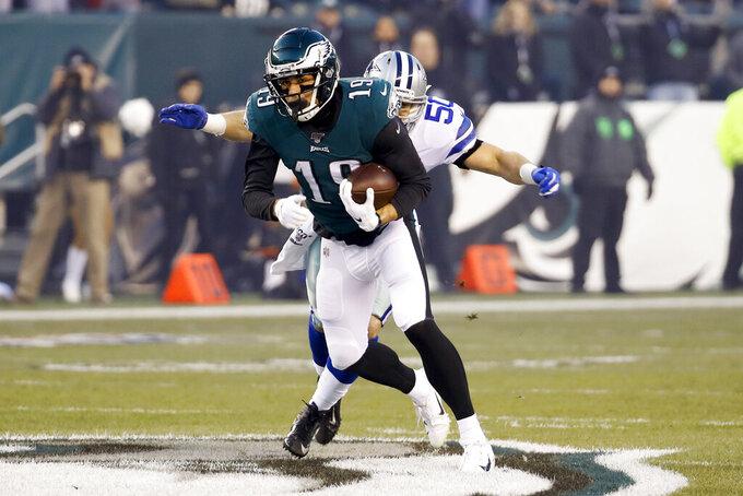 Dallas Cowboys outside linebacker Sean Lee (50) tries to stop Philadelphia Eagles wide receiver J.J. Arcega-Whiteside (19) during the first half of an NFL football game Sunday, Dec. 22, 2019, in Philadelphia. (AP Photo/Chris Szagola)